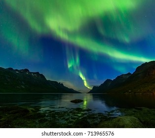 The polar Northern lights in Norway.Tromso.Ershfjord