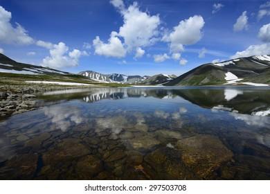 Polar Urals Mountains landscape with a dark lake water Patok. Research ridge, Komi Republic, Russia