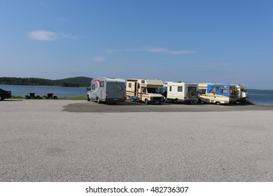 Polarcircel, Sweden - August 5, 2014: RVs parked near a lake at the Polarcircel area in Sweden.