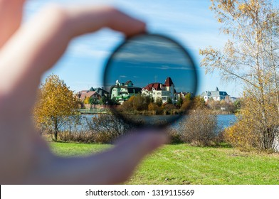 Polarizing filter in action. Polarizing filter for camera lens in photography