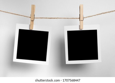 polaroid frame.Retro photo frames hanging on rope isolated on white background. real photo