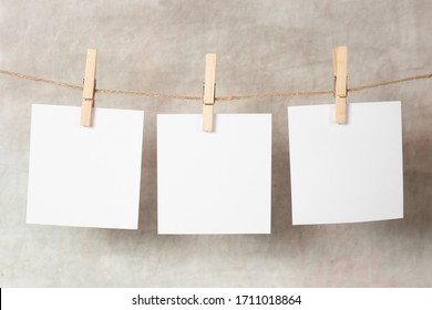 polaroid frame.Retro photo frames hanging on grey background. real photo. - Shutterstock ID 1711018864
