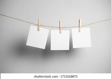 polaroid frame.Retro photo frames hanging on rope isolated on white background. real photo. three frames