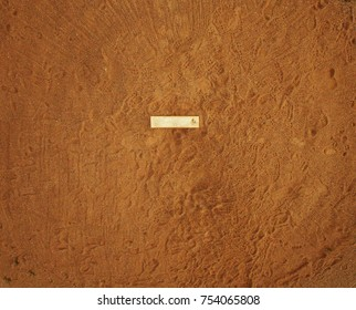 Pole aerial High Dynamic Range (HDR) image of a baseball pitcher's dirt mound with pitching slab and many footprints.
