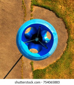 Pole aerial High Dynamic Range (HDR) image of a blue funnel ball structure on a playground.