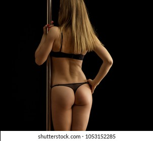 Pole dance. Sexy long-haired girl with elastic ass