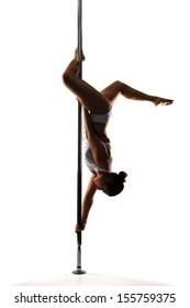 Pole dancer isolated in white