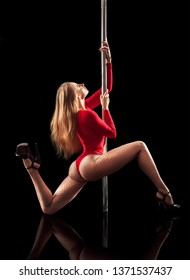 Pole dancing. Sexy blonde dancing on a pole.