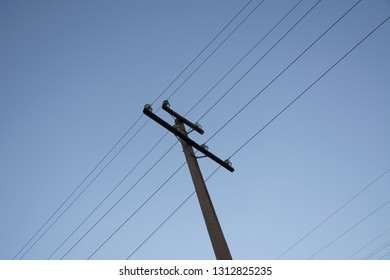 A pole with electrical wires under tension.