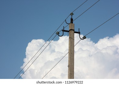 pole with electricity against the blue sky with clouds