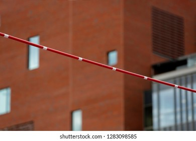 Pole Vault Crossbar on background of the building