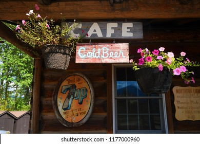 POLEBRIDGE, MONTANA, USA - September 9, 2018: Cafe, Cold Beer and vintage 7Up signs adorn the exterior of the Northern Lights Saloon.