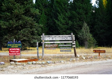 "POLEBRIDGE, MONTANA, USA - September 9, 2018: Welcome to Polebridge sign with business advertising and ""No Fireworks"" signs"