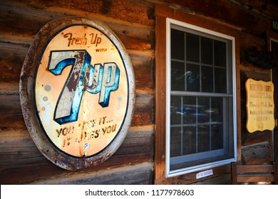 POLEBRIDGE, MONTANA, USA -  September 9, 2018: Vintage 7Up soda sign hangs on the exterior of Northern Lights Saloon