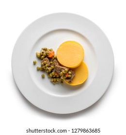polenta, a famous dish of Italian cuisine made with cornmeal, with veal stew, peas and carrots