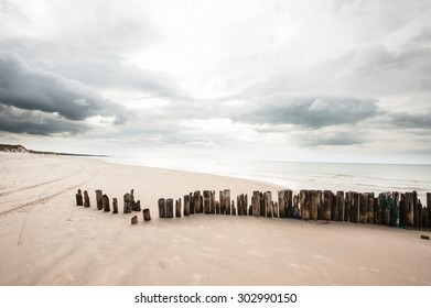 Poles in the sand at the beach in Tversted in Denmark