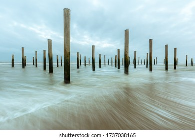 The Poles Village or Palendorp is a monument on the beach of Petten (Netherlands) in memory a historic flooding. Long exposure with sea waves.