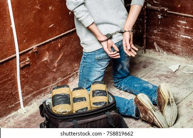 Police arrest drug trafficker with handcuffs. Law and police concept.