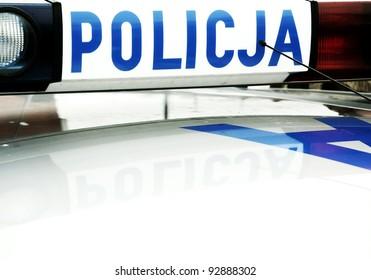 police caption on a police car light bar in Poland