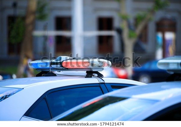 Police car against city street background