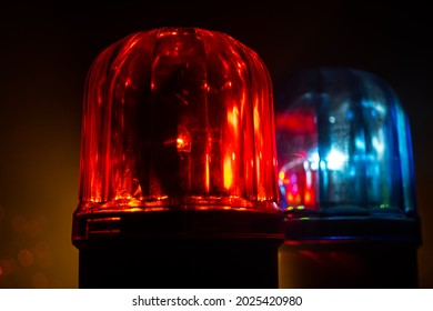 Police car blue and red round vintage siren in dark. Rotating retro style police siren. Selective focus