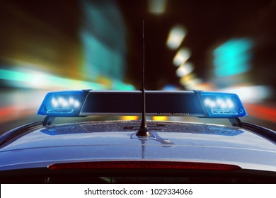 police car driving at night