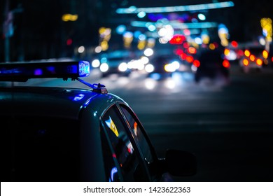 police car lights at night in city with selective focus and boke blur
