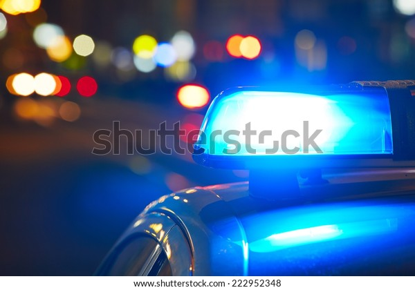 Police car on the street at night