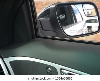 Police car in rear view mirror view from pulled car