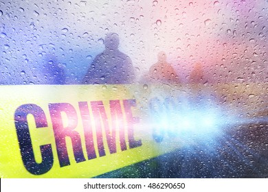 Police crime scene with lights, police tape and raindrops with silhouettes in the background