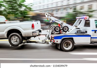police department tow truck delivers the damaged vehicle