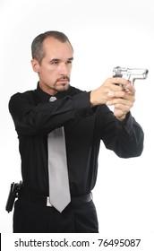 police detective wearing black shirt aiming gun