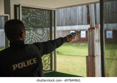 Police drill short guns in the shooting range.