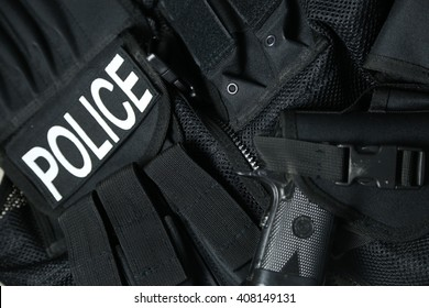 Police Equipment - Tactical vest with logo and firearm