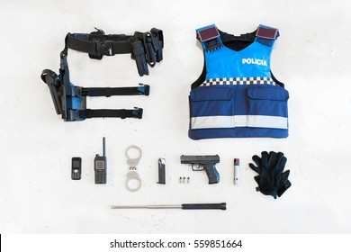 Police equipped with different material in the foreground