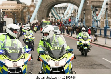 Police escort at the London Torch Relay for Beijing 2008 Olympics