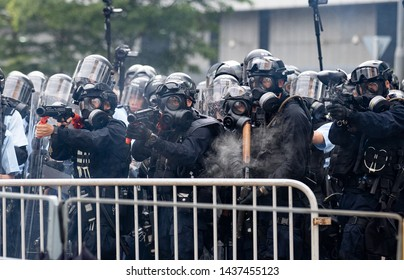 Police firing the tear gas bomb during the protest against extradition to China bill in Hong Kong. Jun 12th 2019