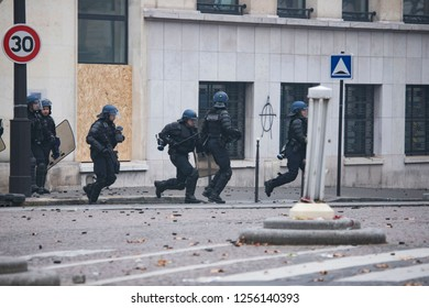 "Police force during the ""Yellow Vests"" antigovernment protest in the French capital. Paris, France - December 8, 2018"
