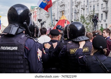 Police is going to push Protesting people Day of Russia rally at Tverskaya Ploshad, Moscow, Russia 12 June 2017