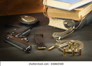 Police gun and badge. Weapons to defend law and order. The right to own a gun. Defense Law. Ombudsmen. Crime and Punishment.