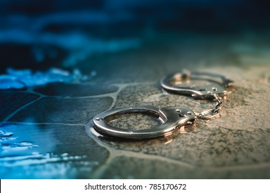 police handcuffs on the street / dramatic lighting