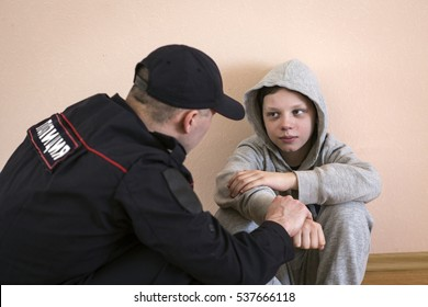 Police Inspector and a teenager.