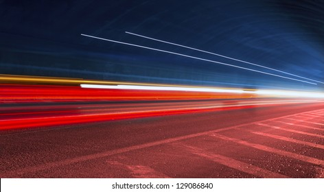 police light trails in tunnel. Art image . Long exposure photo taken in a tunnel