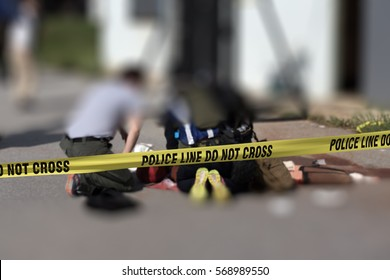 police line cross with blurred medic law enforcement  background in active shooter scenario and medical evacuation training scenario with copy space