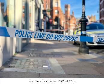 Police line do not cross crime scene perimeter cordon tape in a London street