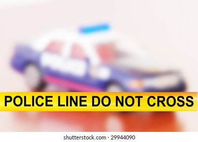 Police line do not cross. Over police car background