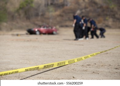 police line do not cross with blurred row of law enforcement searching background in car bomb investigation training with copy space