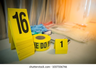 police line and evidence marker with forencsic science tool background on table for crime scene concept with copy space and flare
