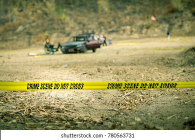police line tape and blurred forensict and explosion wrecked car background with copy space in cinematic tone