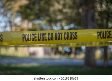 Police Line tape at the scene of a crime.